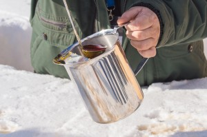 Making maple taffy on snow