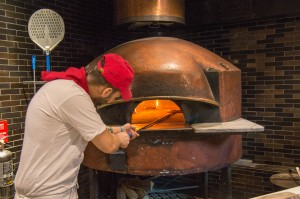 Making pizza in wood fired oven