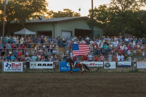 american flag carried by cowgirl