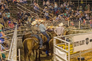 cowboys waiting their turn at rodeo