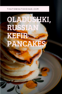 Oladushki are Russian pancakes made with kefir batter. Served hot off the pan with sour cream, butter, honey and jam, they make for a perfect breakfast! #Russia #RussianFood #RussianCuisine #Breakfast #Pancakes #Oladushki